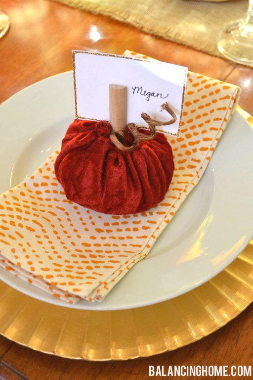 A pumpkin on a plate on a table