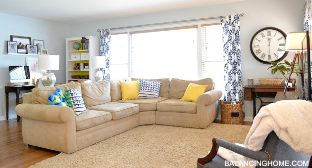 Blue, Green & Yellow Living Room with DIY Stenciled drapes, Pottery Barn Pearce Sectional and a mixture of hand me down items.
