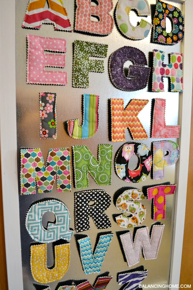 DIY Magnet Board in kids room with fabric magnetic letters from Crunch Baby Farm