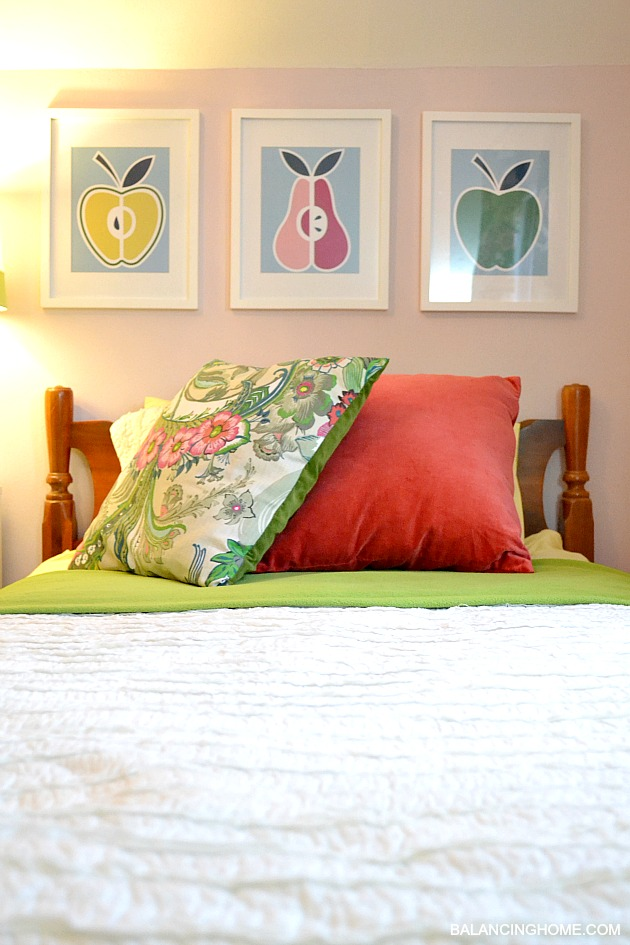 Big Girl Room Reveal- pillow from World Market napkins, ruffled bedding, DIY fruit art