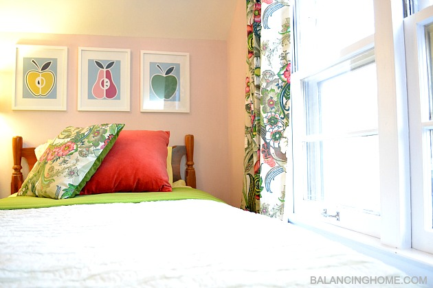 Big Girl Room Reveal- pillow from World Market napkins, ruffled bedding, DIY fruit art, World Market drapes