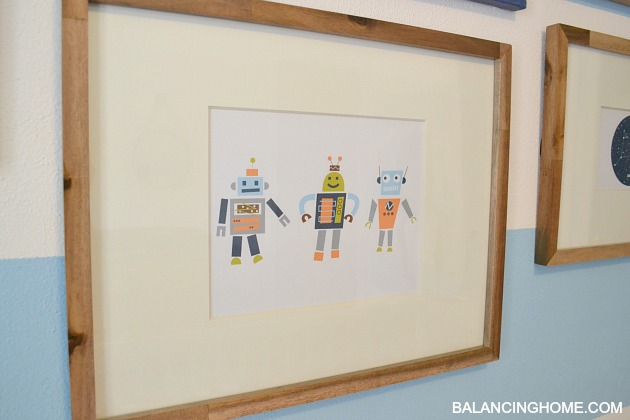 Robot/Space Art in Nursery Gallery Wall with free Blast off Printable.