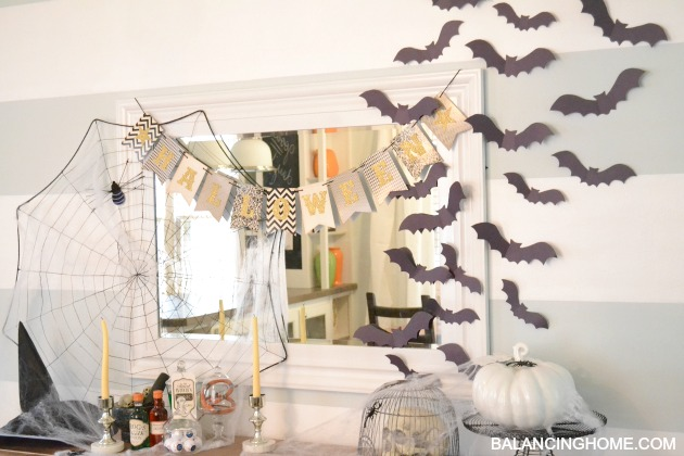 A spooky Halloween mantle that is witch themed.