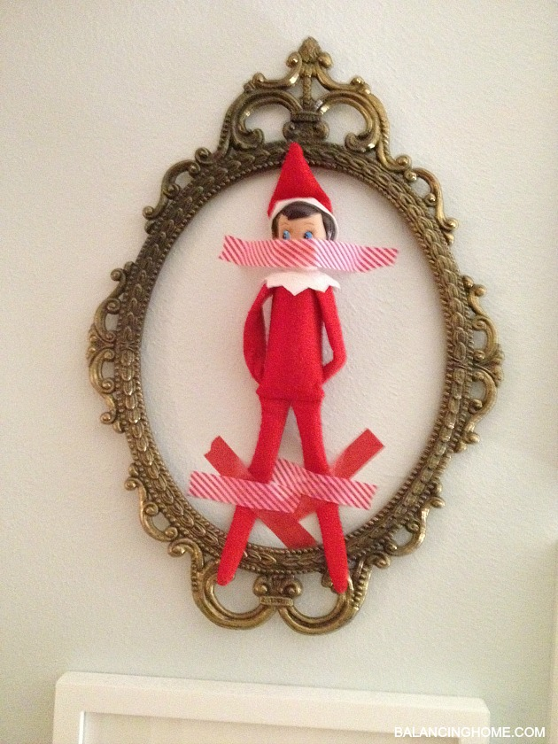 elf-on-the-shelf-taped-to-the-wall